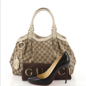 83c4debcf65 Gucci Bags - Gucci Sukey Gg Medium Brown Canvas Tote